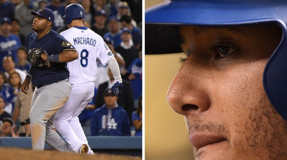 Manny Machado of the Los Angeles Dodgers kicks the leg of Milwaukee Brewers first baseman Jesus Aguilar in the 10th inning in Game 4 of the NL Championship Series at Dodger Stadium on Tuesday. MLB has now fined Machado, right, for the incident.