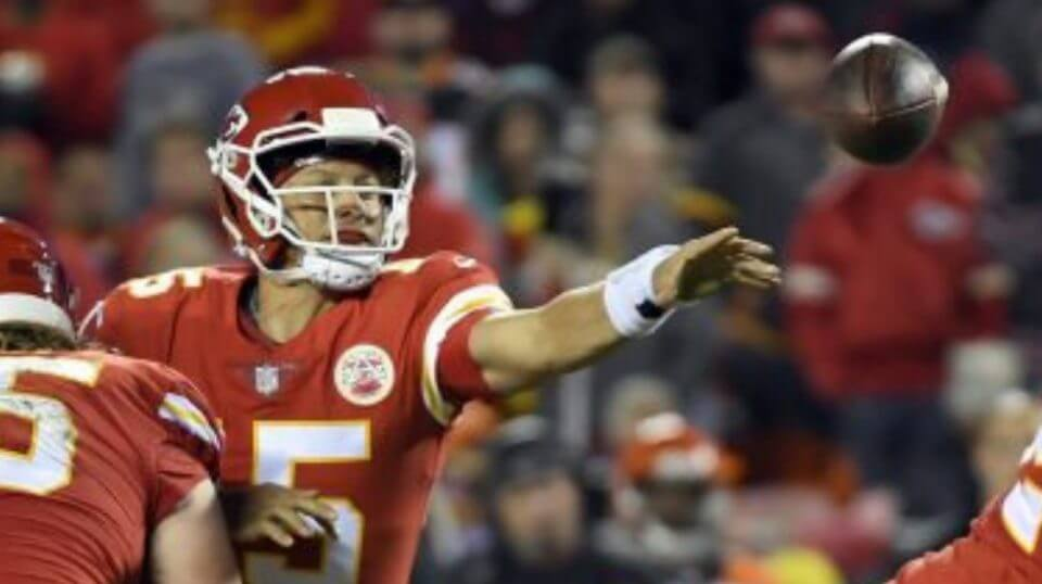 Kansas City Chiefs quarterback Patrick Mahomes (15) throws away the ball with his left hand as he is tackled by Cincinnati Bengals defensive tackle Andrew Billings during Sunday night's game in Kansas City.
