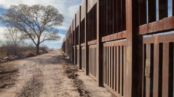 Fencing marks the border between the United States and Mexico near Douglas, Arizona.