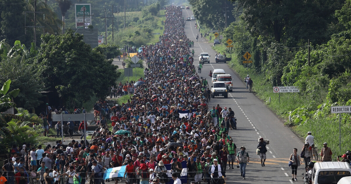 A migrant caravan, which has grown into the thousands, walks into the interior of Mexico after crossing the Guatemalan border on Oct. 21, 2018, near Ciudad Hidalgo, Mexico.