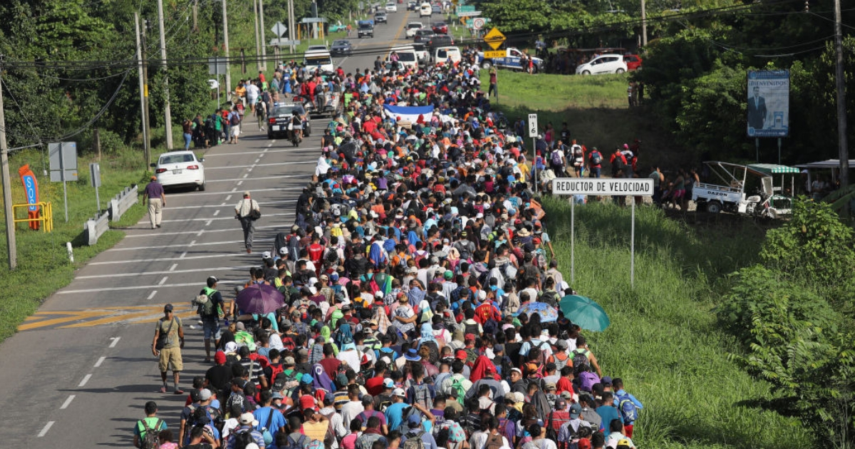 Thousands of people in a migrant caravan walk into the interior of Mexico after crossing the Guatemalan border Sunday near Ciudad Hidalgo, Mexico.