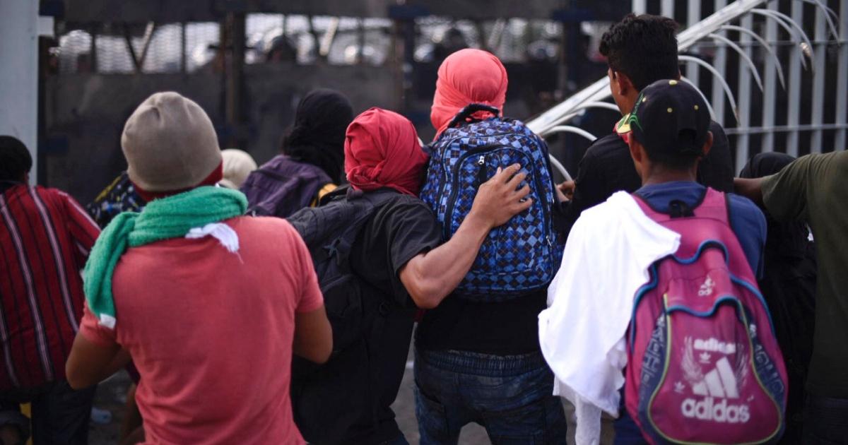 Honduran migrants taking part in a caravan heading to the U.S. tear down the border fence between Ciudad Tecun Uman in Guatemala and Ciudad Hidalgo, Mexico.