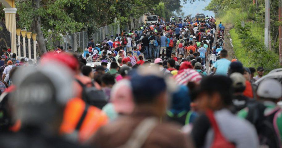 A caravan of more than 1,500 Honduran migrants moves north after crossing the border from Honduras into Guatemala