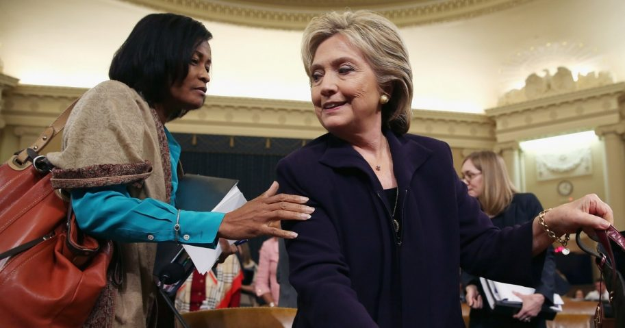 Former State Department Chief of Staff Cheryl Mills, left, and Democratic presidential candidate and former Secretary of State Hillary Clinton take a break in a hearing of the House Select Committee on Benghazi on Oct. 22, 2015, on Capitol Hill in Washington.