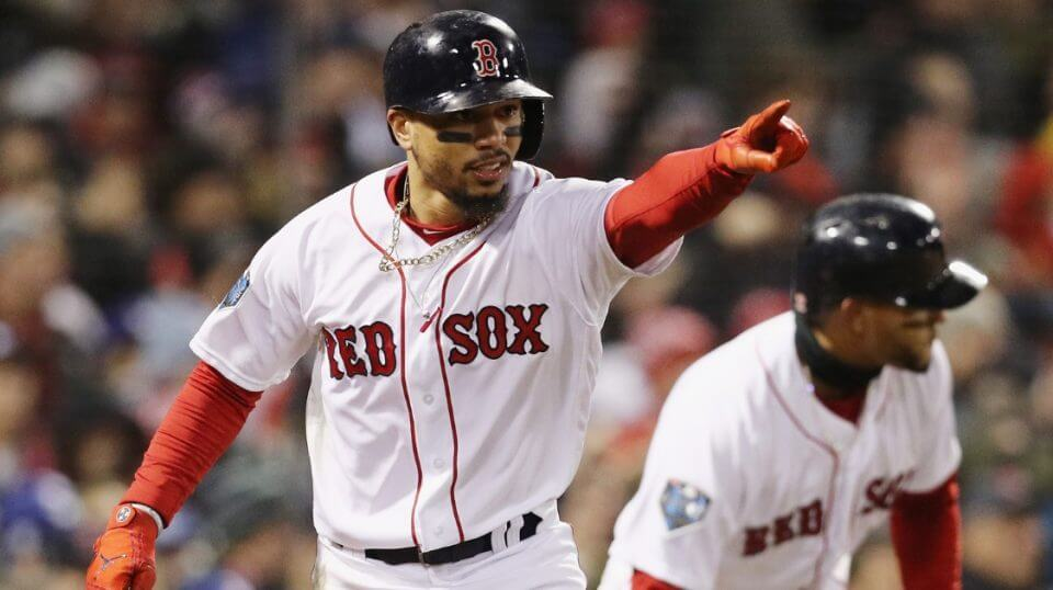 Mookie Betts of the Boston Red Sox celebrates after scoring against the Los Angeles Dodgers in Game 2 of the World Series at Fenway Park on Wednesday.