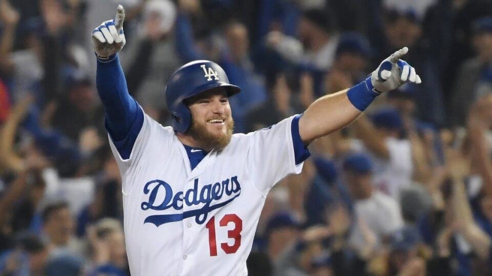 Max Muncy of the Los Angeles Dodgers celebrates his 18th-inning walk-off home run to defeat the the Boston Red Sox 3-2 in Game 3 of the World Series at Dodger Stadium on Friday.