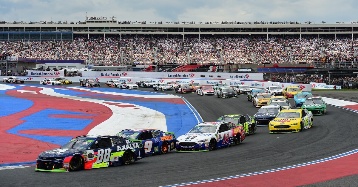 Alex Bowman, driver of the #88 Axalta Chevrolet, leads a pack of cars during the Monster Energy NASCAR Cup Series Bank of America Roval 400 at Charlotte Motor Speedway on Sunday.