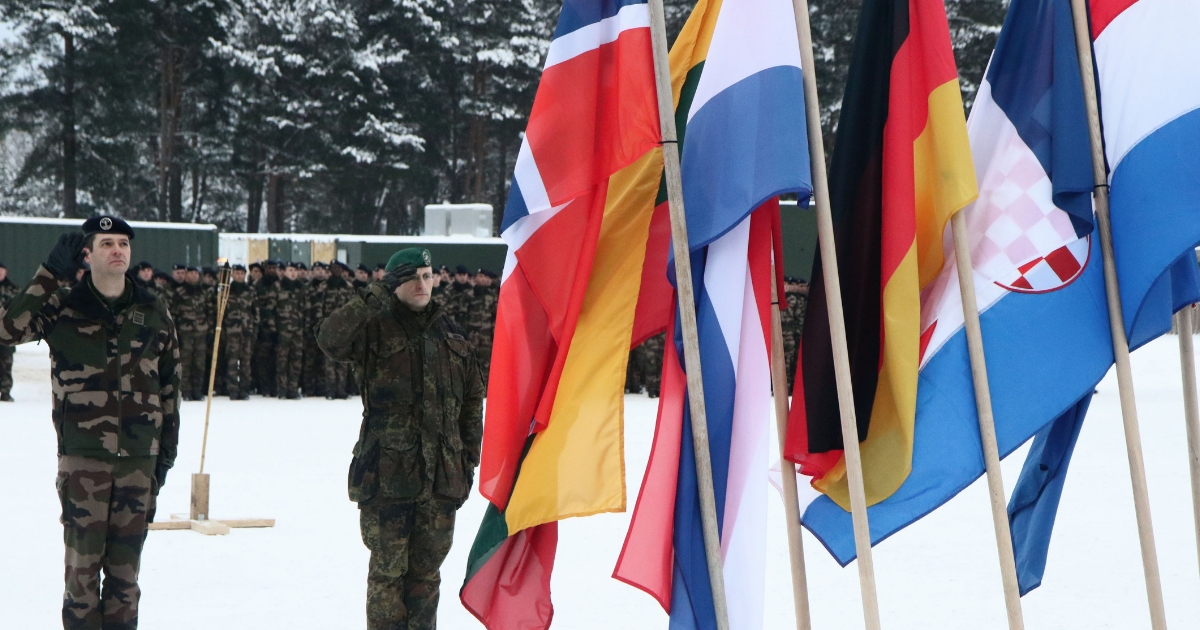 Commander of the NATO eFP battalion battlegroup and the German contingent in Lithuania, Lieutenant Colonel Thorsten Gensler (R) and Commander of the French contingent Lieutenant Colonel Martin Wencesl salute during the handing over ceremony greeting French soliders arriving for the beginning of their service with the NATO enhanced Forward Presence Battalion Battle Group in Rukla, Lithuania, on Jan. 22, 2018.