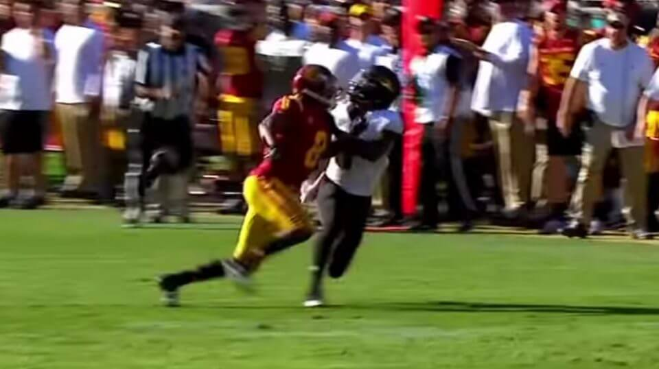 Arizona State's N'Keal Harry, right, battles a USC defender for position prior to making a one-handed catch Saturday.