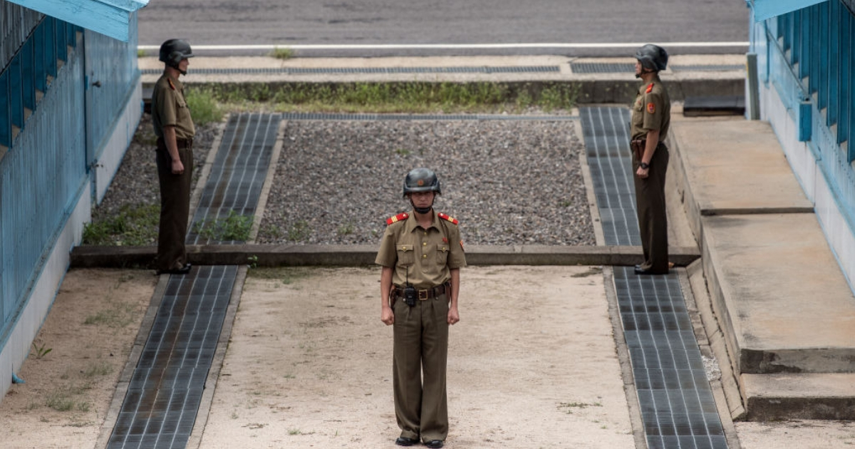 North Korean soldiers stand guard on the North Korean side of the Joint Security Area in the Demilitarized Zone.
