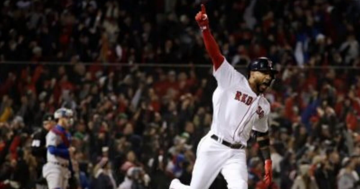 Boston's Eduardo Nunez reacts after hitting a three-run home run during the seventh inning of Game 1 of the World Series on Tuesday in Boston.