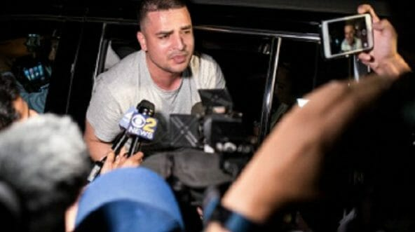 Pablo Villavicencio Calderon, an illegal immigrant, is shown surrounded by the media after his arrest at a New York City Army base while delivering a pizza in July.