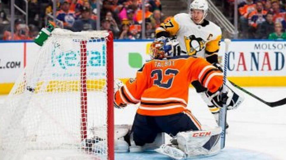 Edmonton Oilers' goaltender Cam Talbot reacts as Pittsburgh Penguins' Sidney Crosby scores during the first period Tuesday in Edmonton, Alberta.