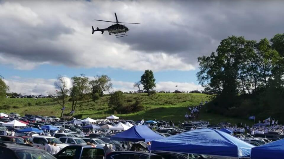 A police helicopter flies over Penn State tailgaters before the Nittany Lions' game against Ohio State on Saturday.