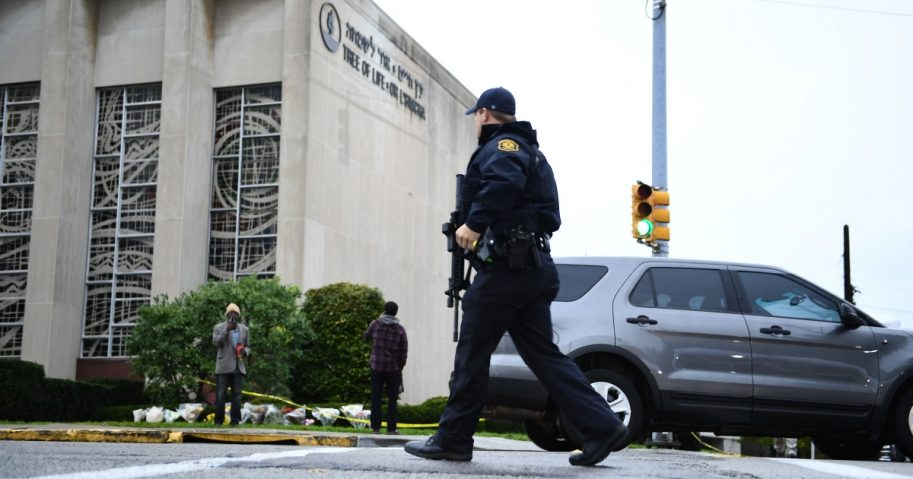 A member of the police crosses the street outside the Tree of Life Synagogue