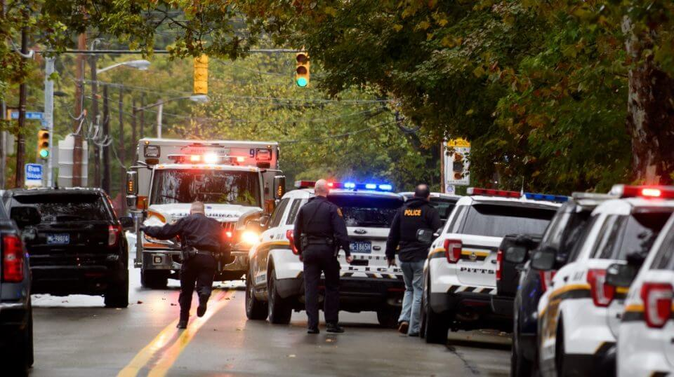 Police officers respond to the site of a mass shooting at the Tree of Life Synagogue in the Squirrel Hill neighborhood of Pittsburgh on Saturday.