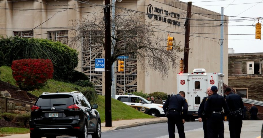 First responders stand outside the Tree of Life Synagogue in Pittsburgh, where a shooter opened fire Saturday.