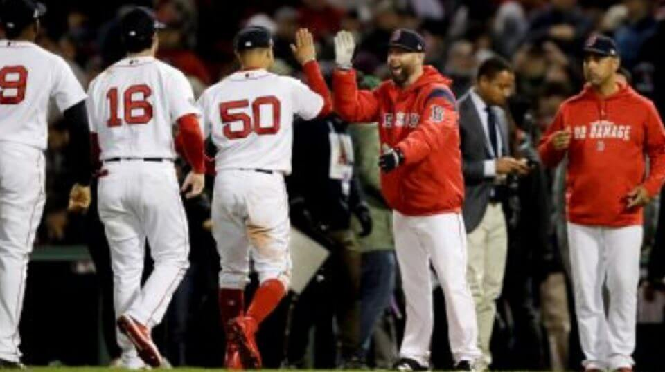 Members of the Boston Red Sox celebrate after their 7-5 win Sunday against the Houston Astros in Game 2 of the American League Championship Series in Boston.