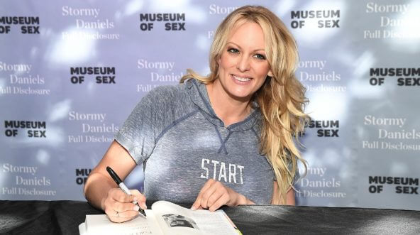 """Porn star Stormy Daniels signs copies of her book """"Full Disclosure"""" Monday at Museum of Sex in New York City."""
