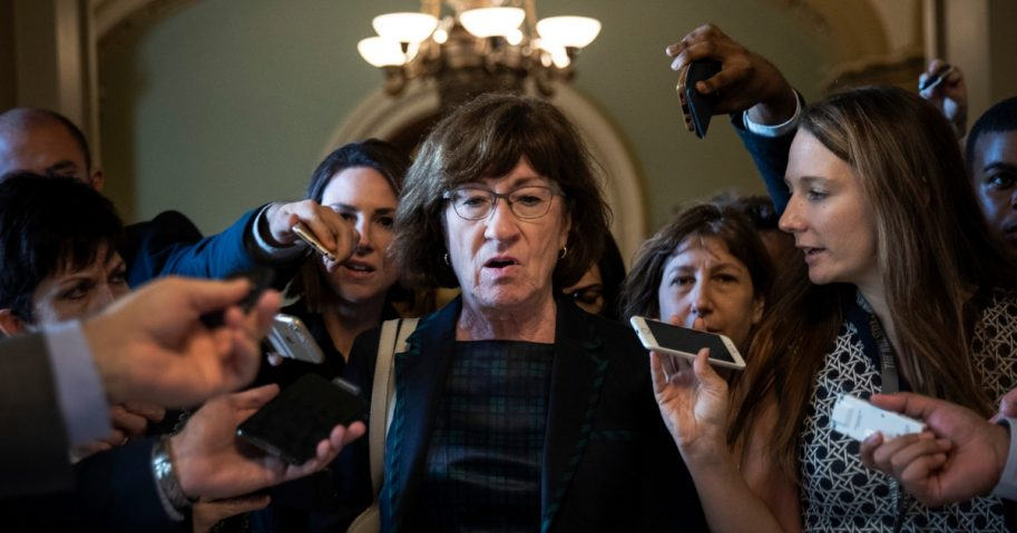 Sen. Susan Collins, R-Maine, is surrounded by reporters following a Sept. 26 meeting on Capitol Hill about the Supreme Court nomination of Brett Kavanaugh.