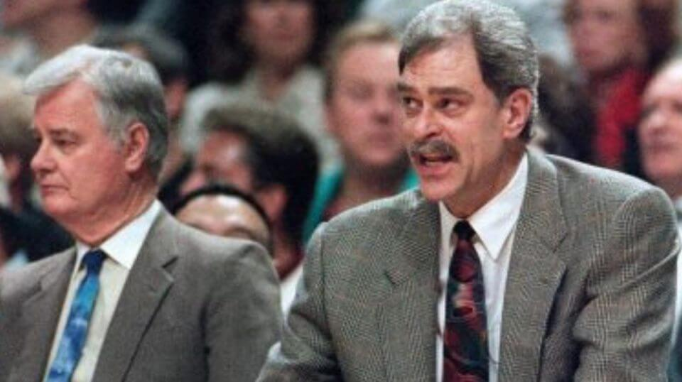 Chicago Bulls coach Phil Jackson, right, argues a call against his team, as he sits next to assistant coach Tex Winter during the 1995 NBA Playoffs.