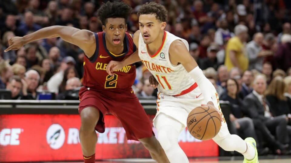 Atlanta's Trae Young (11) drives past Collin Sexton during Atlanta's 133-111 victory.