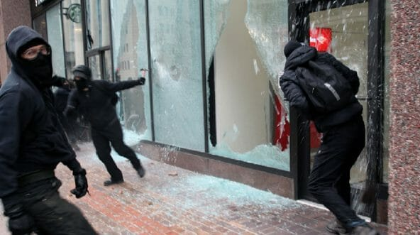 Rioters smash windows of a Bank of America and a Starbucks in Washington on the day of President Donald Trump's inauguration in 2017.