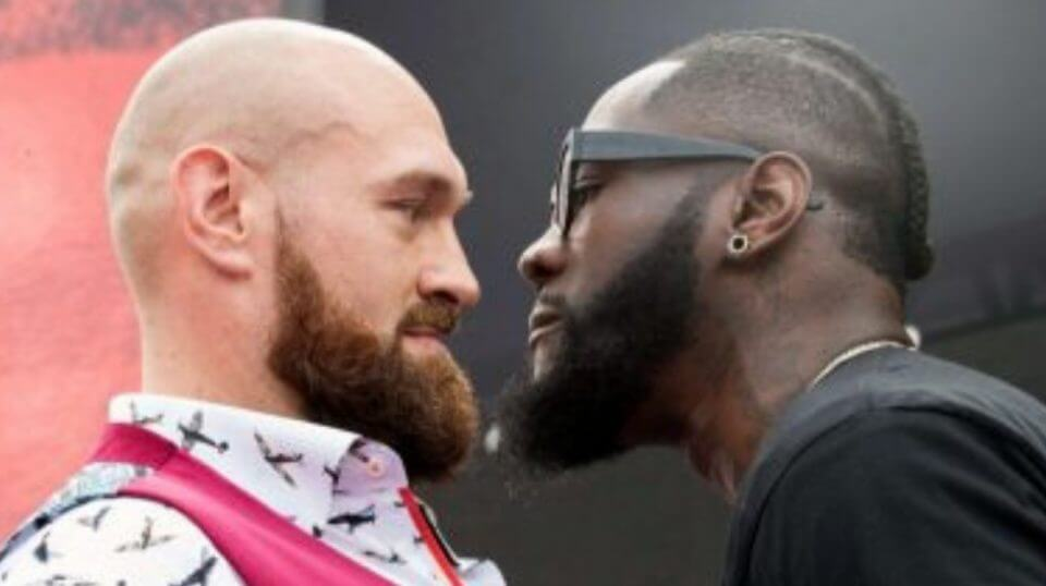Tyson Fury, left, and Deontay Wilder face off Tuesday during a news conference in New York ahead of their heavyweight world championship boxing match in Los Angeles on Dec. 1.
