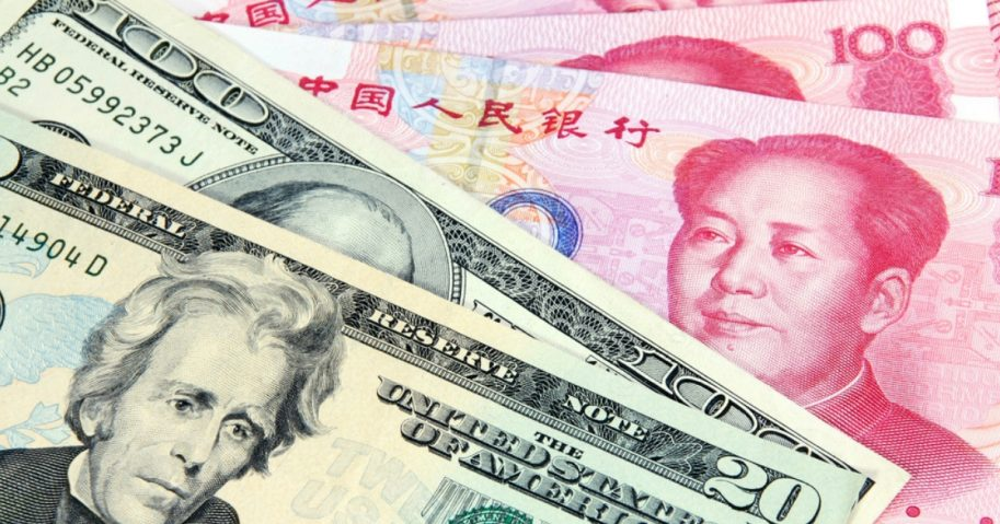 U.S. currency alongside Chinese currency