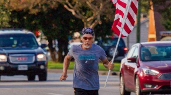 Wayne Parfitt carries an American flag with him each time he goes for a run as a salute to all military personnel, including his son.