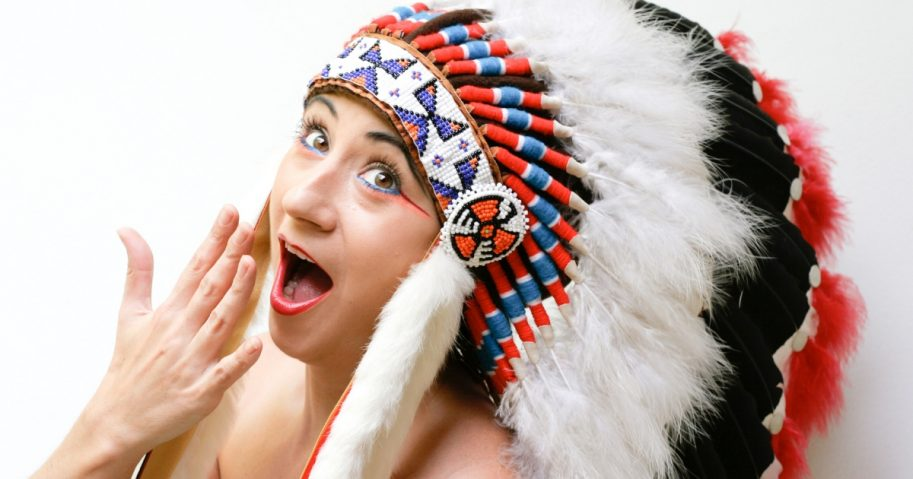 A woman wearing a traditional Native American headdress