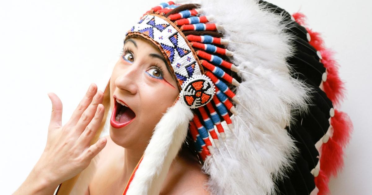 A woman wearing a traditional Native American headdress