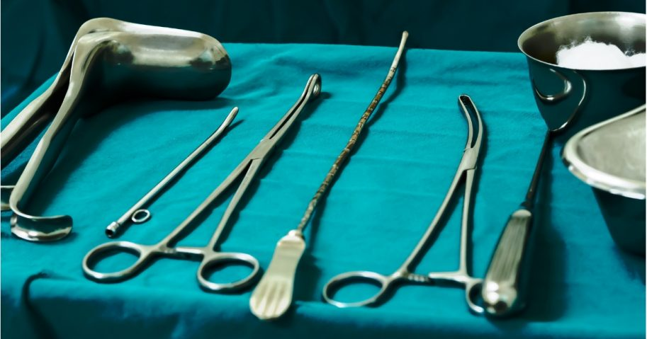 Sterile curettage tools, forceps, retractor in operation room at medical hospital for abortion.