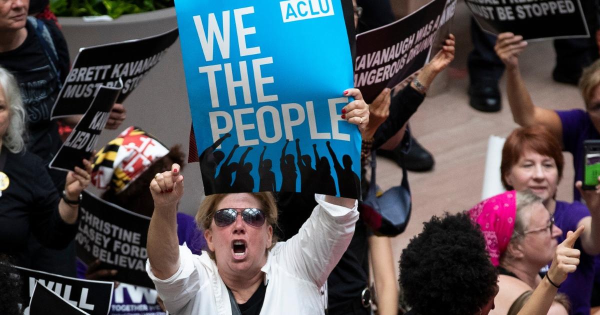 Protestors rally against Supreme Court nominee Judge Brett Kavanaugh in the atrium of the Hart Senate Office Building.