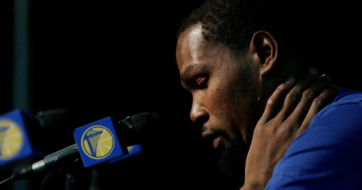 Golden State Warriors' Kevin Durant listens to a question from a reporter before the team's NBA preseason basketball game against the Sacramento Kings, Friday in Seattle.