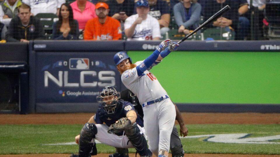 Justin Turner hits a two-run home run during the eighth inning of Game 2 of the National League Championship Series against the Brewers Saturday in Milwaukee.