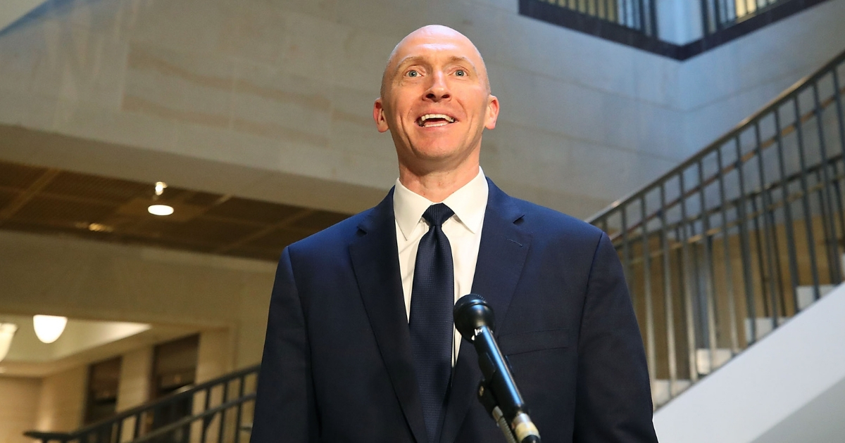Carter Page, former foreign policy adviser for the Trump campaign, speaks to the media after testifying before the House Intelligence Committee