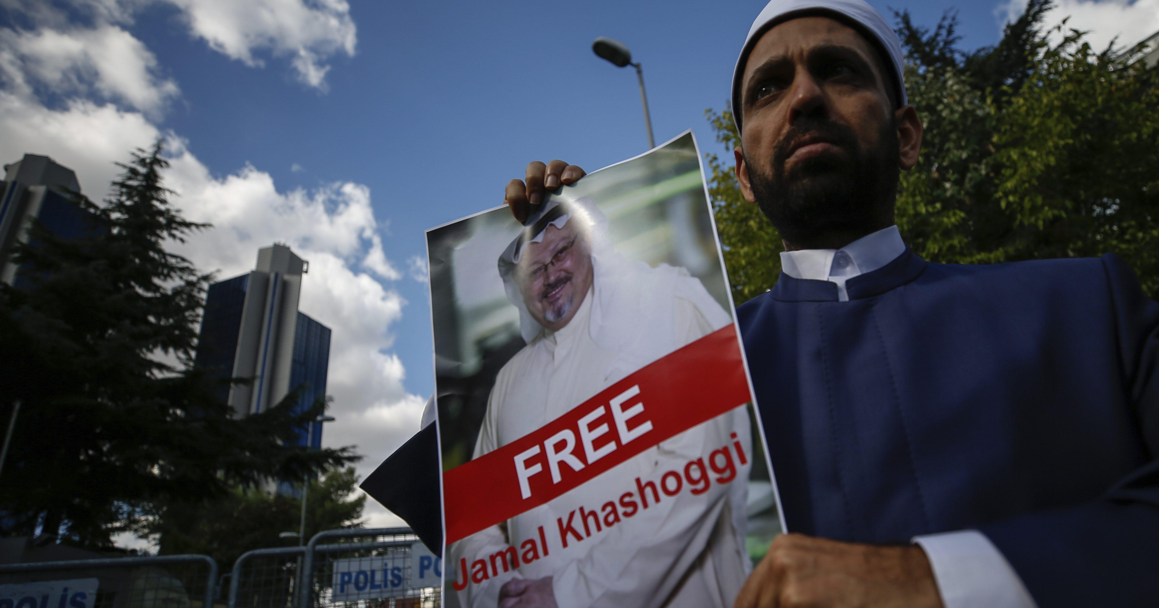 Holding a poster of missing Saudi writer Jamal Khashoggi, a man stands near the Saudi Arabia consulate in Istanbul,
