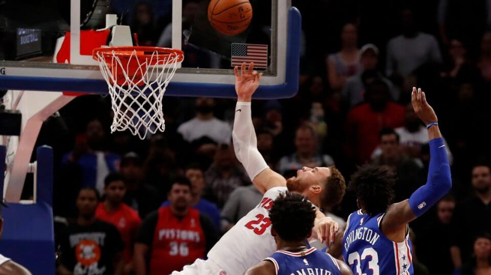 Detroit Pistons forward Blake Griffin (23) is fouled by Philadelphia 76ers forward Robert Covington (33) as he makes the basket to tie the game in overtime Tuesday in Detroit.