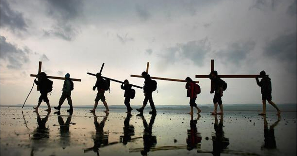 A group of people carrying crosses.
