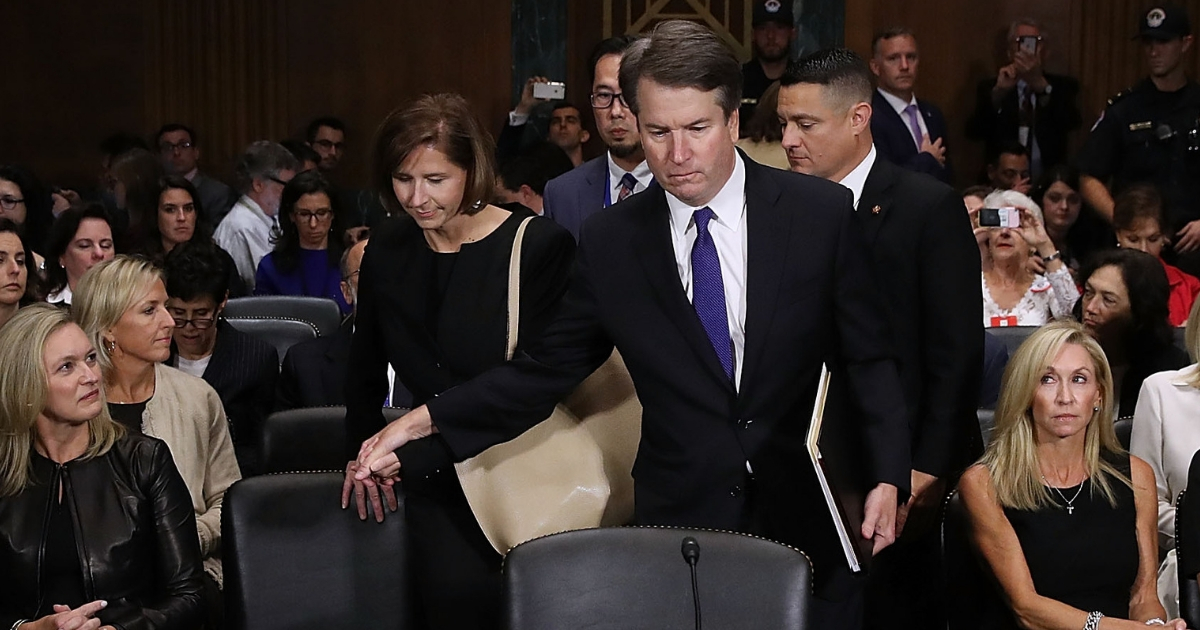 udge Brett Kavanaugh (C) holds hands with his wife Ashley Kavanaugh as he arrives to testify to the Senate Judiciary Committee.