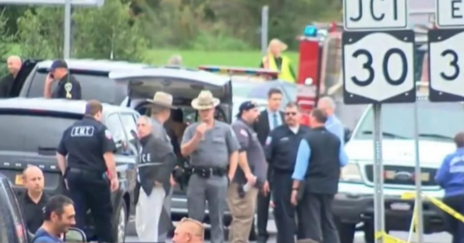 Police and first responders gather at the scene of an accident involving a limosuine van that left 20 people dead.