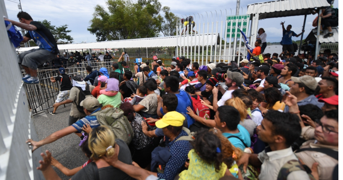 Caravan Gets Aggressive, Tears Down Gate in Clash with Mexican Police
