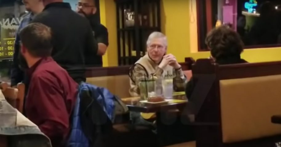 Mitch McConnell harassed at restaurant.
