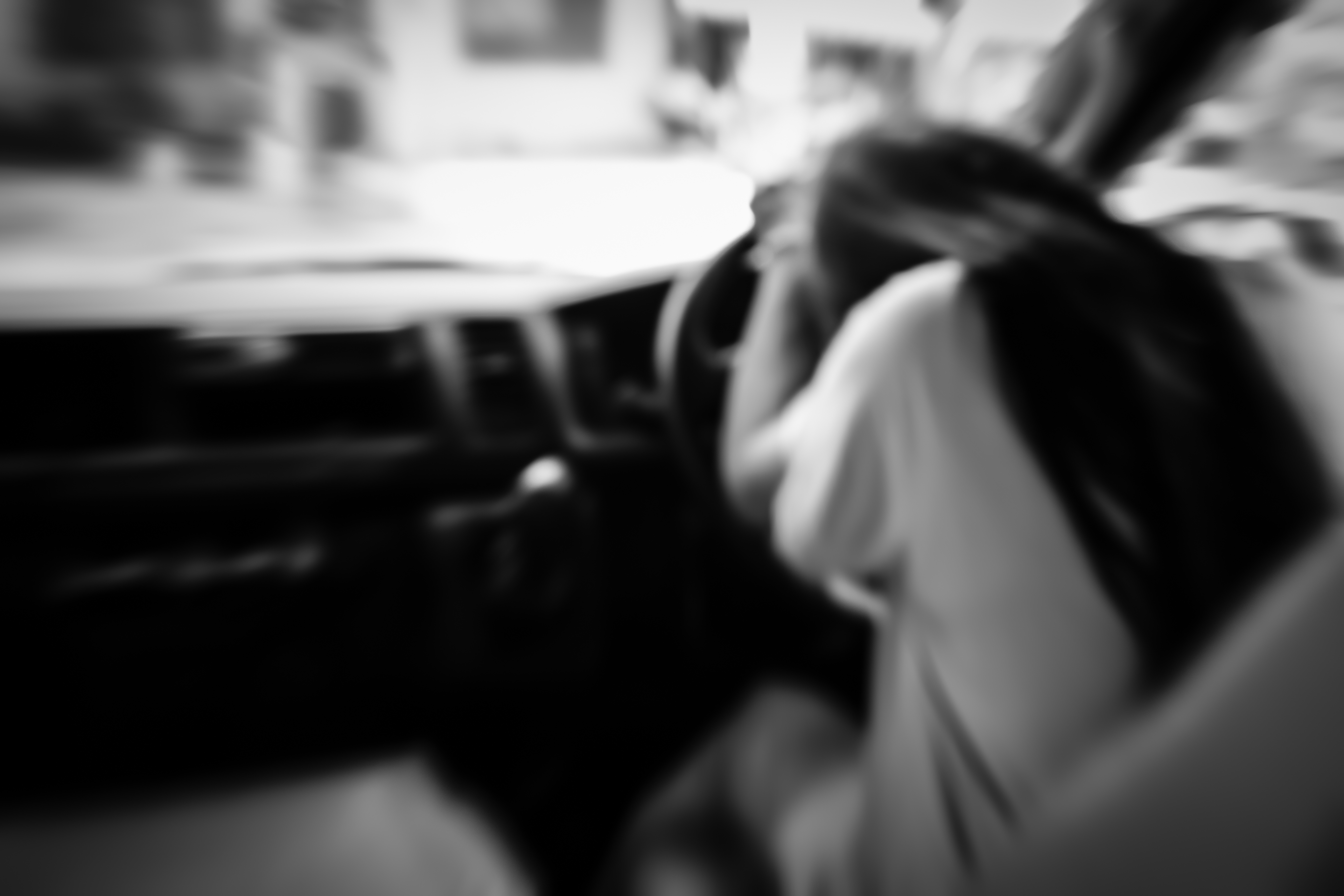 Sad woman in car,blurry emotion black and white.