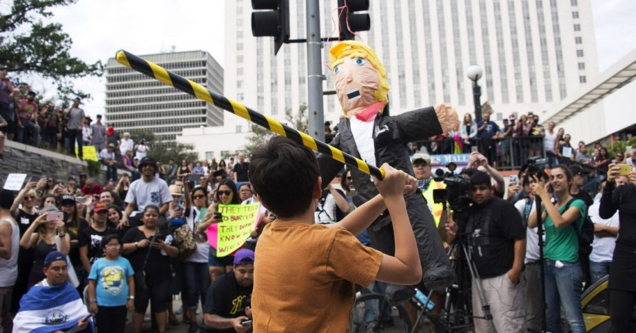 A Donald Trump pinata is hit as thousands of people protest in the streets against President-elect Donald Trump in front of Federal Building on November 12, 2016 in Los Angeles, California.