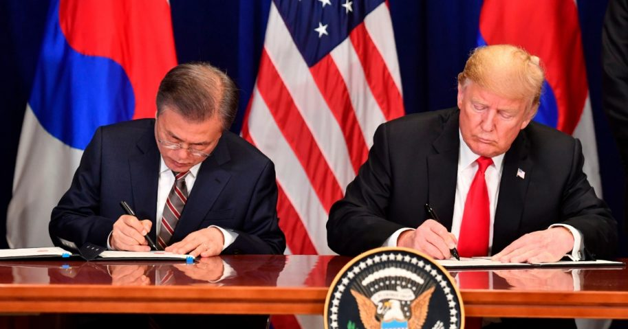 U.S. President Donald Trump and South Korean President Moon Jae-in sign a trade agreement