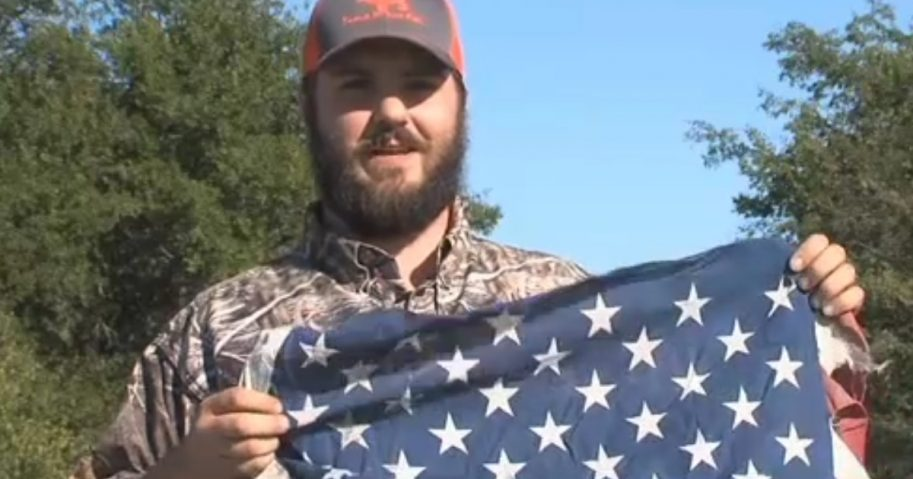 Veteran holding tattered flag