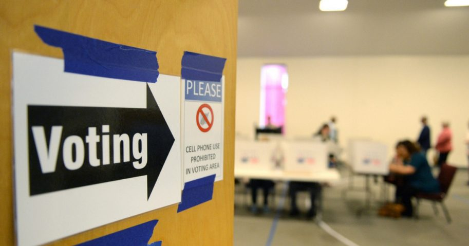 A sign directing people to voting booths