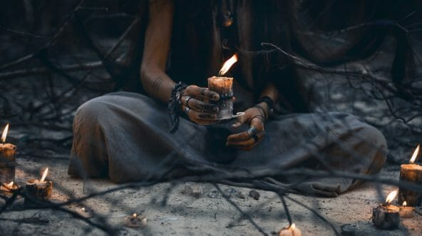 woman holding candles, witch